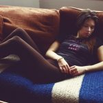 girl laying on couch looking off