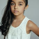 Young girl with dark hair in portrait session by Christopher String